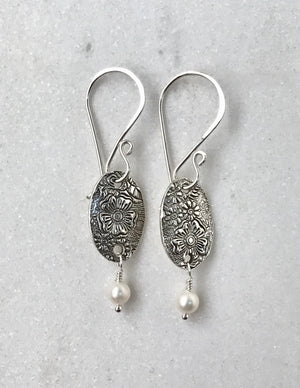 silver floral oval dangle earrings with white pearl drops