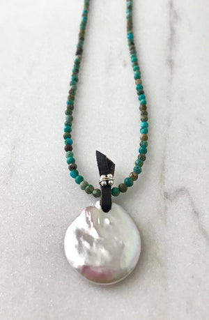 small faceted blue turquoise bead necklace with a large white freshwater pearl coin pendant