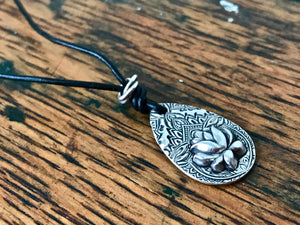 thin black leather cord necklace with silver teardrop shaped lotus flower pendant