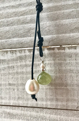long tied black leather cord necklace with large freshwater pearl and green garnet pendants