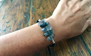 adjustable black leather cord bracelet with black and gray rutilated quartz gemstones