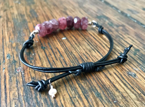 adjustable black leather bracelet with faceted pink ruby rondelle gemstones