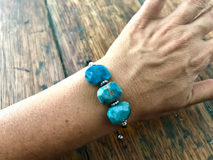 adjustable leather cord bracelet with three large faceted blue apatite gemstones with sterling silver accent beads