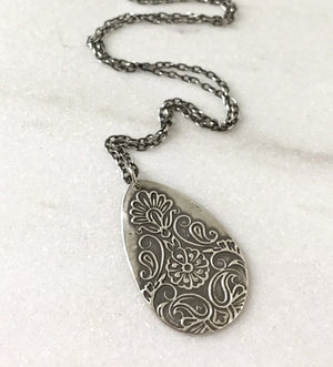 large embossed silver filigree teardrop pendant on sterling silver chain