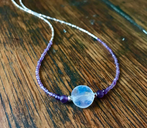 beaded necklace with tiny faceted sterling silver and amethyst beads and a white moonstone coin