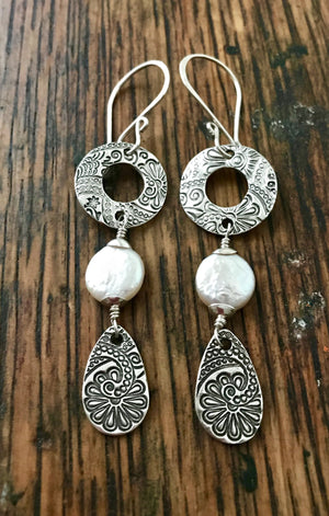 long silver floral and paisley geometric dangle earrings with white coin pearls
