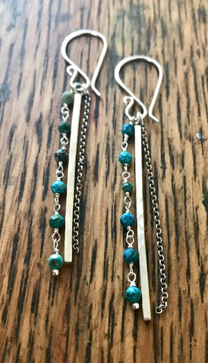 long dangle earrings with a silver hammered bar, chain and blue gemstones