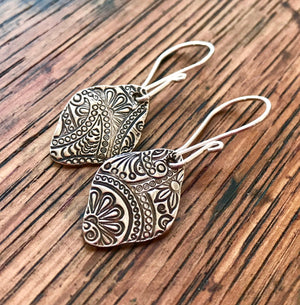 Shield Shaped Silver Embossed Floral and Paisley Dangle Earrings