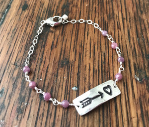 silver heart and arrow valentines bracelet with pink ruby links and silver chain