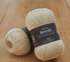 Blacker Yarns - Pure BFL Laceweight 2 Ply Ivory Tree Coral Yarn spool