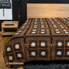 crocheted brown bedspread