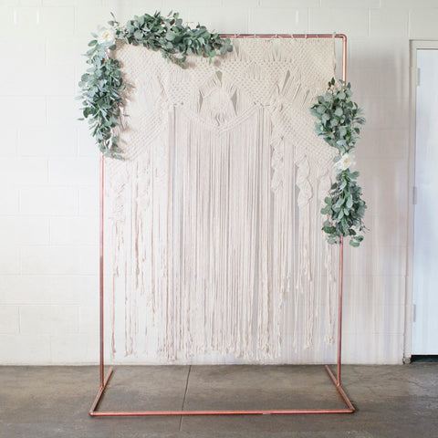Copper and macrame backdrop