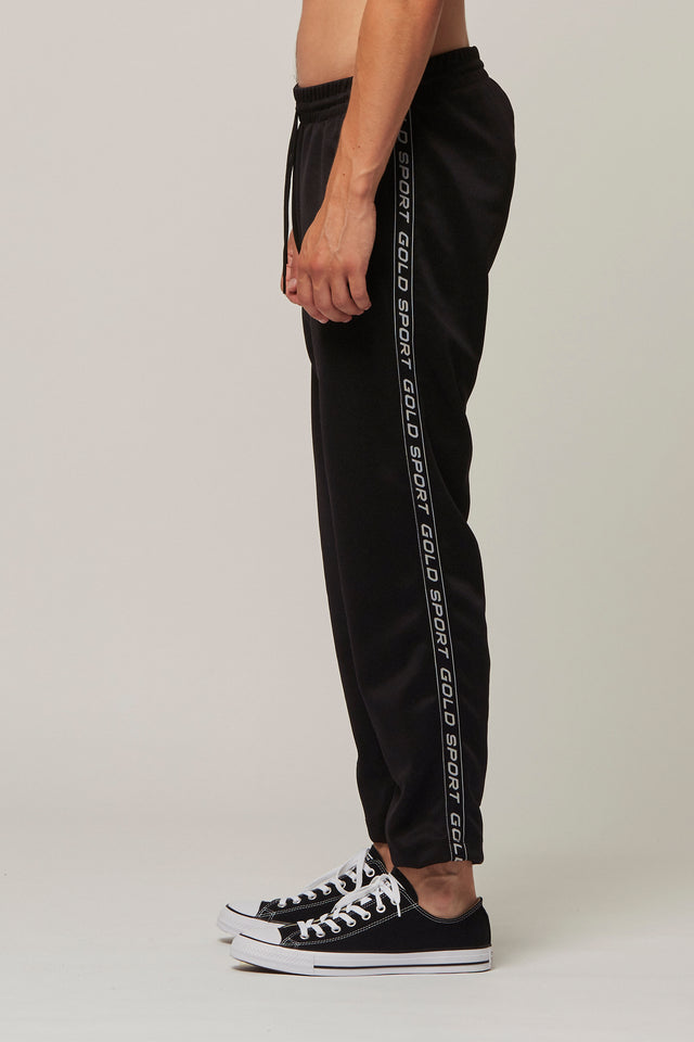 Logo Tape Tracksuit Bottoms, Gold Sport - SWIM XYZ