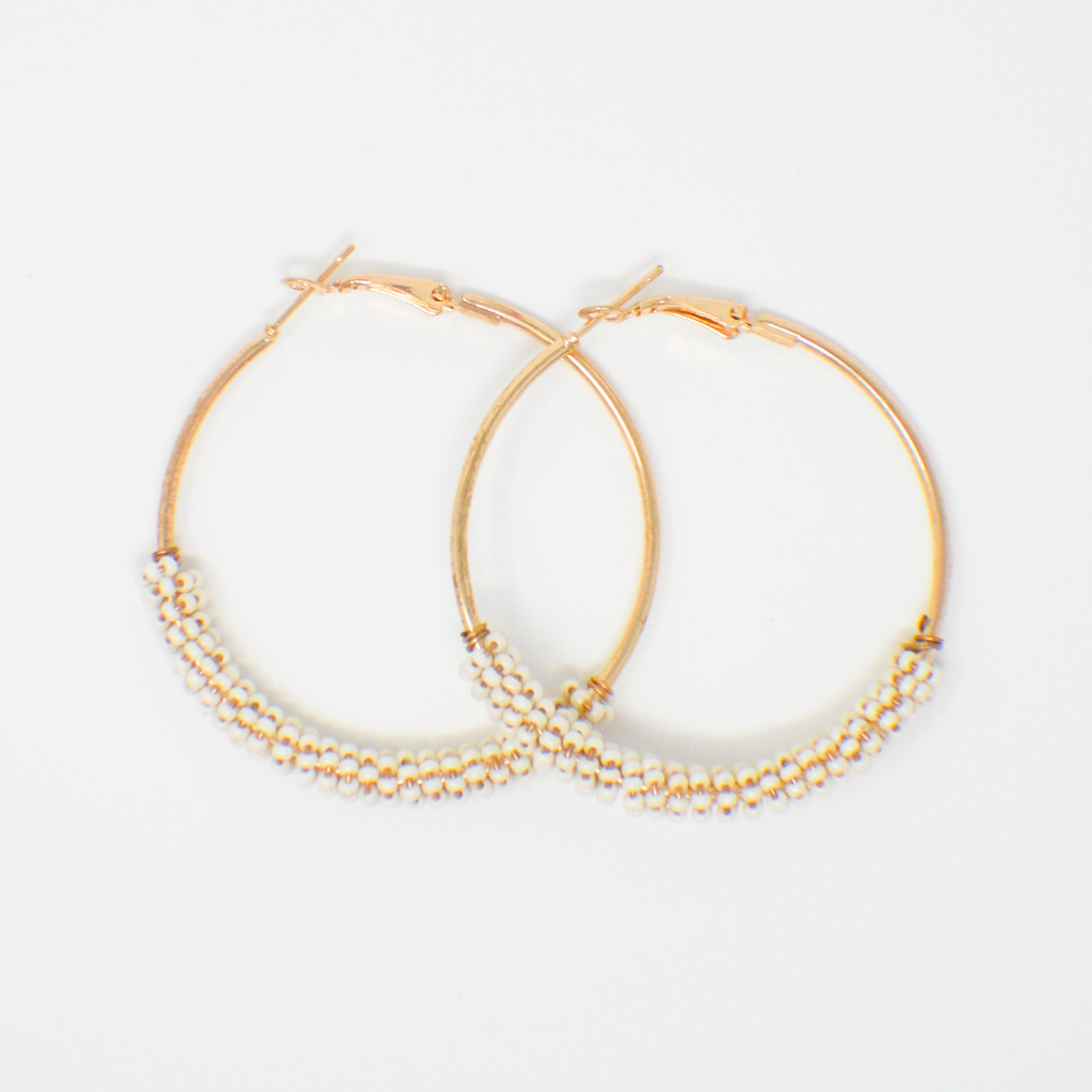 607 White Beaded Hoop Earrings