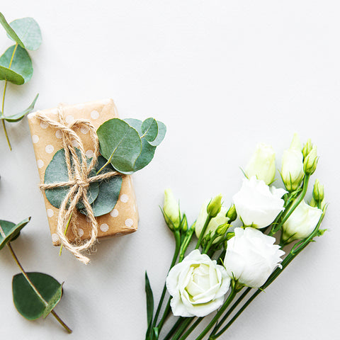 "alt=""bundle of white roses and eucalyptus gift"""