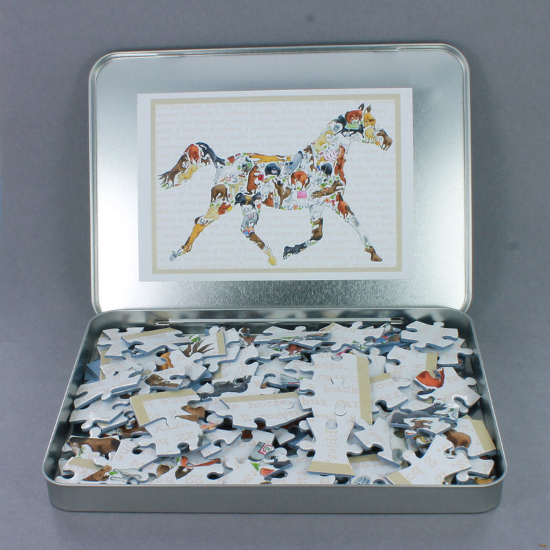 Jigsaw pieces in a silver tin