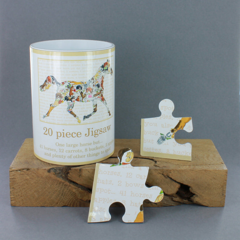 20 piece jigsaw puzzle pieces in a tin by Louise Tate