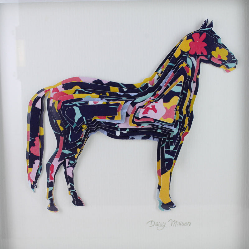 Framed picture of a horse made out of floral cardboard stacked on top of each other