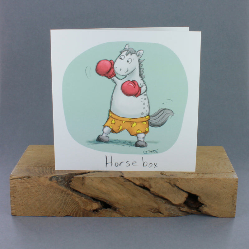 Greeting card with an image of a horse wearing boxing gloves