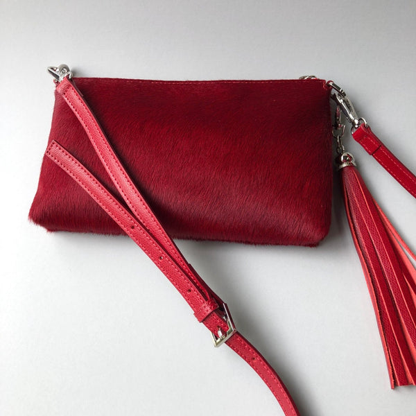 Red hide furry clutch bag with tassle