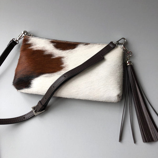 Cow Hide Cluth Bag with tassle attachment