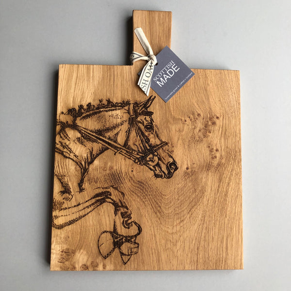 Oak serving board with horse carved in