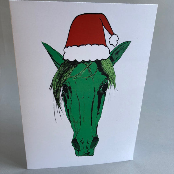 White Christmas Card with Green horse head wearing santa hat