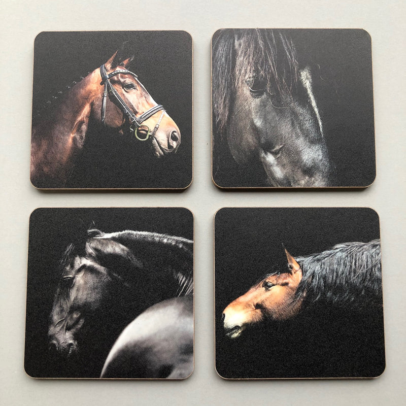 Set of 4 black wooden backed coasters with horse head images on