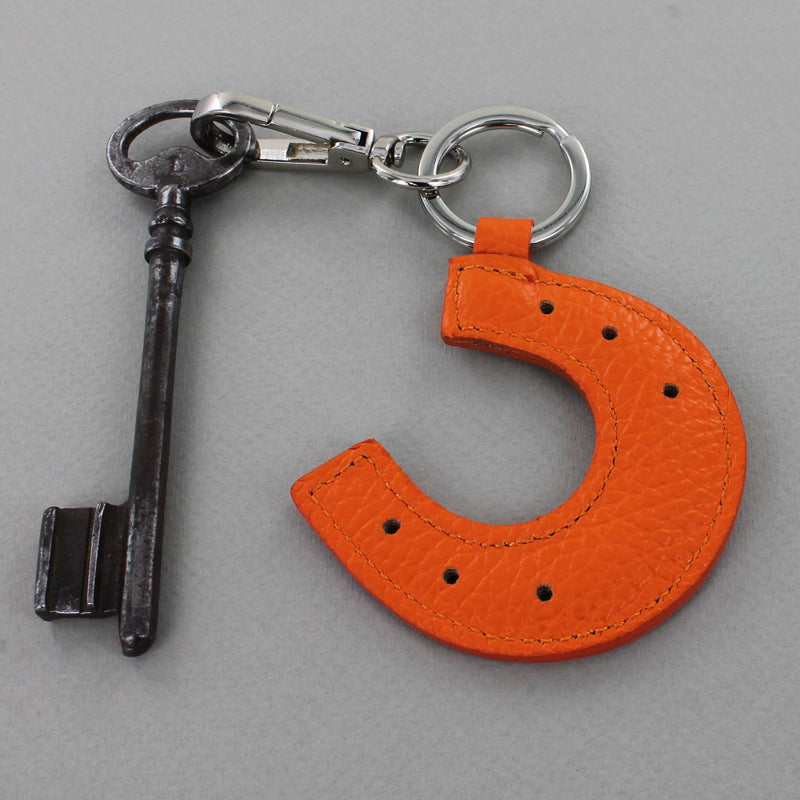 Burnt orange Leather Keyring in horseshoe shape attached to key