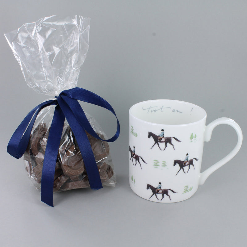 Sophie Allport trot on mug with milk chocolate horseshoes tied with a blue ribbon