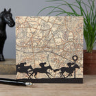 Greeting card with ordnance survey map of Ascot and racing horse silhouettes at the forefront