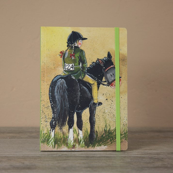 Journal with horse and rider printed on front. Green elastic holding journal shut