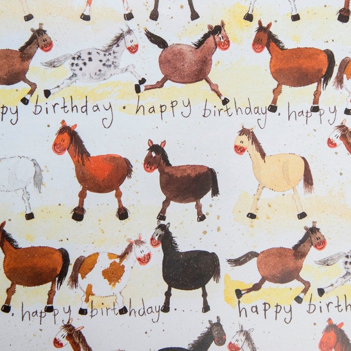 Horses Birthday Wrapping Paper by Alex Clark with happy birthday written across and cartoon horses pattern