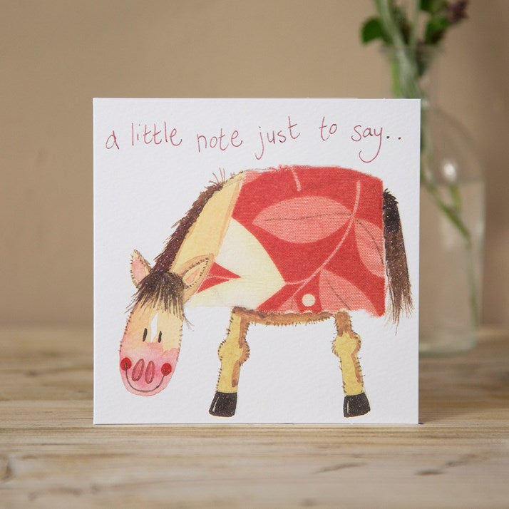 Greeting card with 'a little note just to say' and a cartoon horse on the front