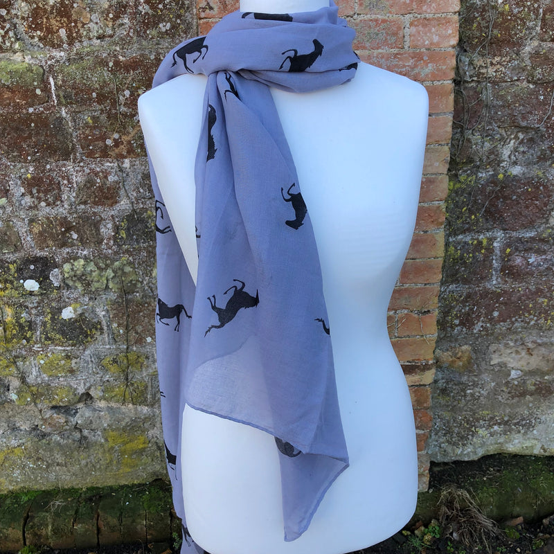 Grey scarf with black hrose print on a mannequin