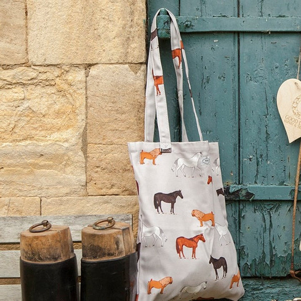 Grey Horses Print Book Bag hung on a stable door