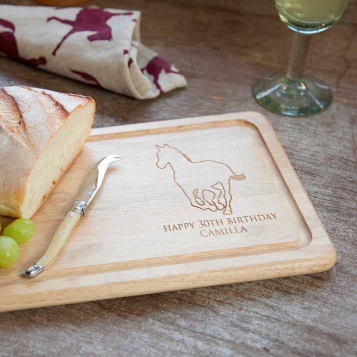 Wooden rectangular bread board with personalised text 'happy 30th birthday camilla' and horse emblem