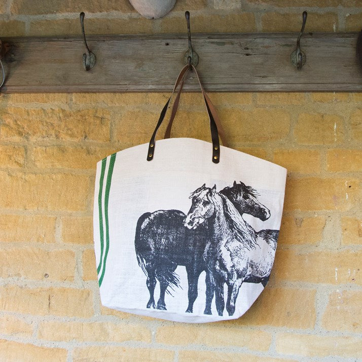 White Jute Horses Shopper with 2 green racing stripes and 2 horses in grey sketched on the front. Brown leather strap