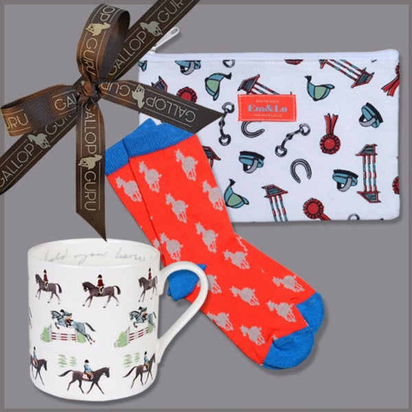 Gift box with bone china horse mug, red and blue childrens socks wtih galloping horses on, and childrens horse themed wash bag