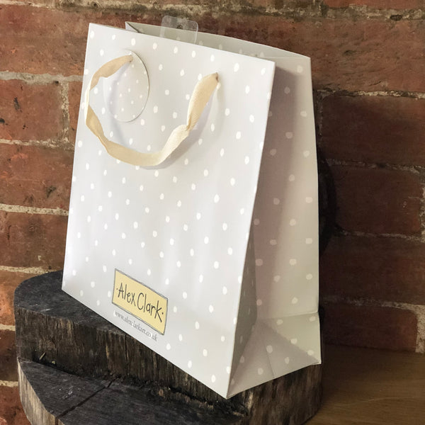 Spotty Alex Clark gift bag with cream cotton handles