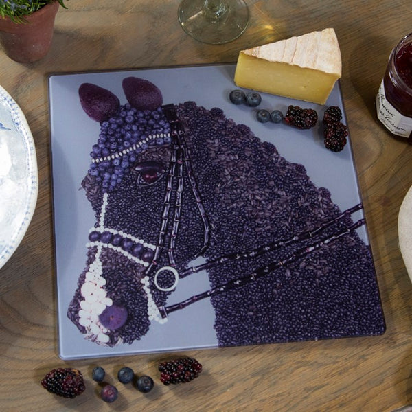 King of Dressage Chopping Board. Horse made out of blackberries and blueberries with avocado ears
