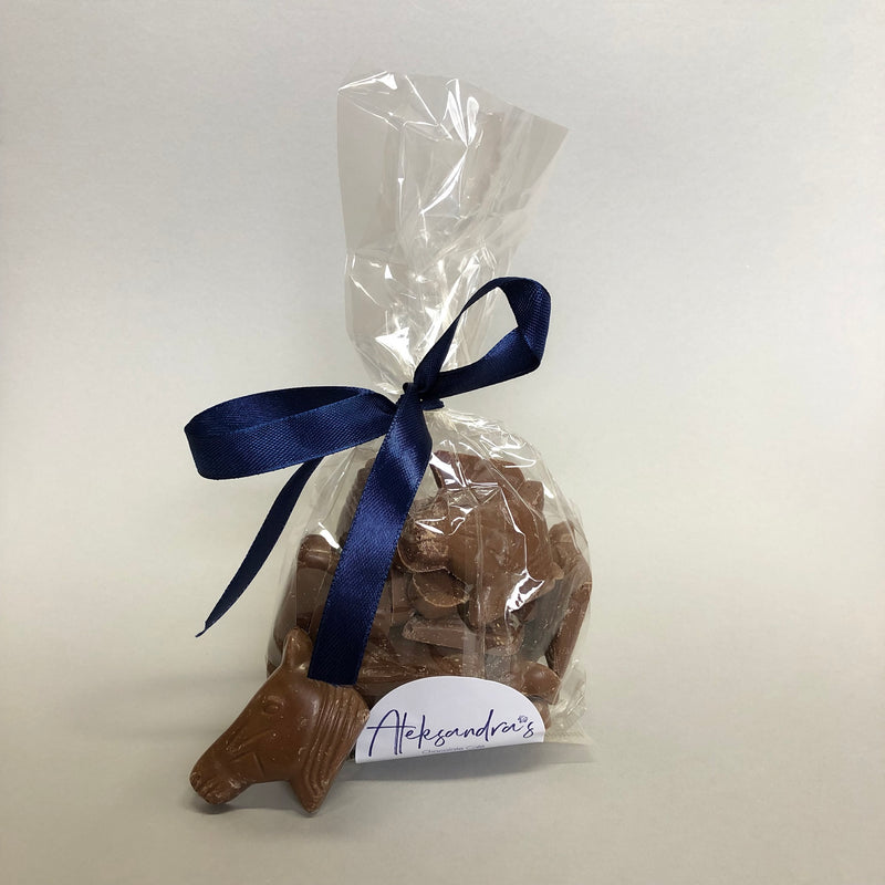Bag of milk chocolate shaped horse heads, tied with blue ribbon