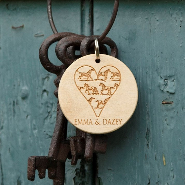 Round wooden keyring with heart shape filled with horses and personalised names