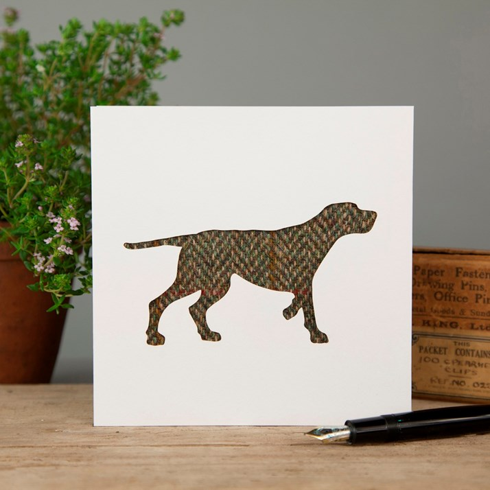 White greeting card with cut out of a dog in tweed fabric