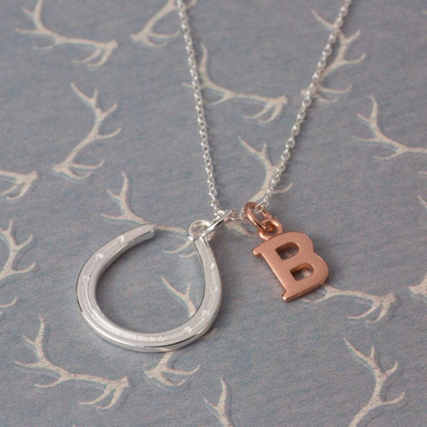 Sterling silver horseshoe charm and rose gold vermeil 'B' charm on a silver chain