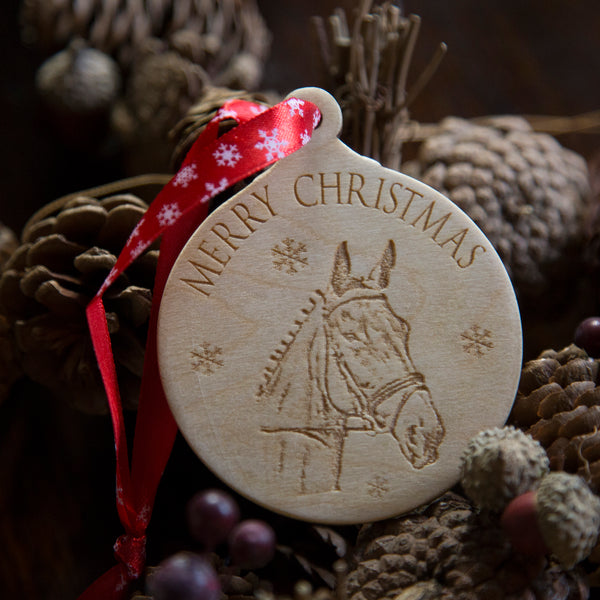 Wooden christmas tree decoration with red ribbon with snowflakes on. personalised with a horse image