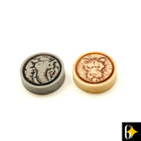The backgammon playing discs includes the light carved disc with a lion's face and the dark carved disc with an elephant's face on it.