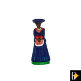 Perspective view of the magnet depicting a Herero woman wearing a blue dress. Buy this African curio now.