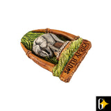 Perspective view of the elephant with tusk frame magnet. Buy this African curio now.