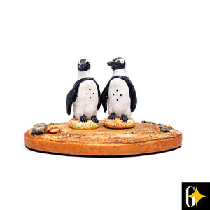 Top view of the penguin pair figurine. Buy this African gift now.
